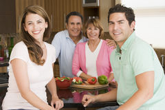 Family Preparing A Meal Together Royalty Free Stock Images