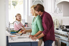 Family Preparing Roast Turkey Meal In Kitchen Together Stock Photos