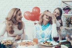 Family Preparing Surprize for Grandmother at Home royalty free stock photography