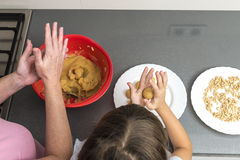 Family preparing sweets in the kitchen Royalty Free Stock Images