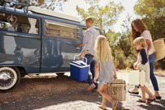 Family preparing their camper van for a road trip, side view stock images