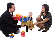 Family with presents. Mother, father and son with presents isolated on white Stock Image