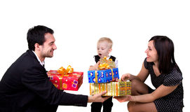 Family with presents. Mother, father and son with presents isolated on white Royalty Free Stock Image