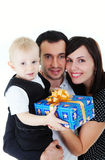 Family with presents Stock Images