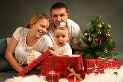 Family with presents Royalty Free Stock Photos