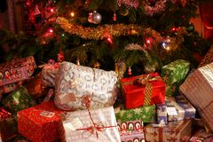 Family Presents. Around the base of the christmas tree Royalty Free Stock Image