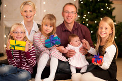 Family with presents at Christmas royalty free stock photography