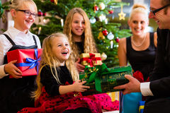 Family with presents on Christmas day Royalty Free Stock Image