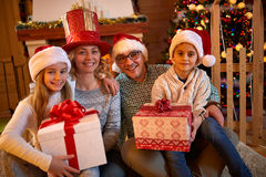 Family with presents for Christmas Stock Photo