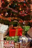 Family presents round the tree. Family presents piled up around the base of the christmas tree Stock Photo