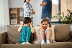 Sad children and parents quarreling at home royalty free stock photography