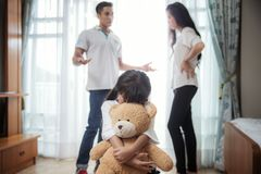 Family problem. Father and mather is fighting but daughter very sad, this picture can use for kid and children problem, family broken concept stock photos