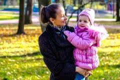 Family promenade in autumn park Royalty Free Stock Photo
