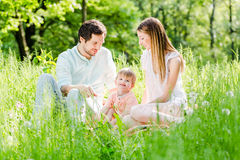 Family protecting child taking son in the middle Royalty Free Stock Image