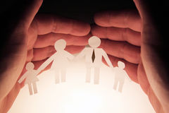 Family protection. Man protecting his family concept Royalty Free Stock Photos