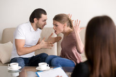Family psychologist counseling. Couple quarrelling, shouting and Stock Images