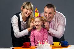 Family pulling on their daughter's ears Royalty Free Stock Images