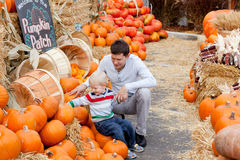 Family at the pumpkin patch stock photos