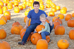 Family at the pumpkin patch. Family of father and son spending fun time together at the pumpkin patch Royalty Free Stock Photography