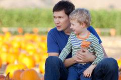 Family at the pumpkin patch. Family of father and son spending fun time together at the pumpkin patch Royalty Free Stock Images