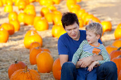 Family at the pumpkin patch. Family of father and son spending fun time together at the pumpkin patch Royalty Free Stock Photo