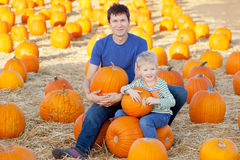 Family at pumpkin patch. Happy family having fun at pumpkin patch at fall Stock Photography