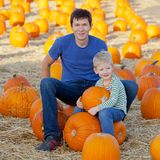Family at pumpkin patch. Happy family of two having fun at pumpkin patch Royalty Free Stock Images