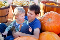 Family at pumpkin patch. Happy family of two having fun at pumpkin patch Royalty Free Stock Photos