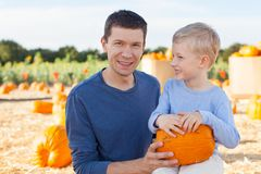 Family at pumpkin patch. Family of two at pumpkin patch Royalty Free Stock Photos
