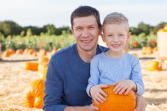 Family at pumpkin patch Stock Images