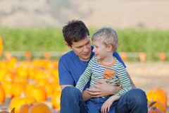 Family at pumpkin patch. Family of two at the pumpkin patch, fall fun Royalty Free Stock Photos