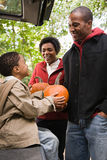 Family with pumpkins Stock Images
