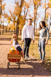 Family with pumpkins Royalty Free Stock Image