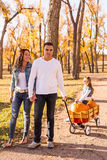 Family with pumpkins Stock Photography