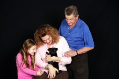Family with puppy Royalty Free Stock Photos