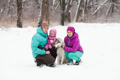 The family with the puppy Royalty Free Stock Photography