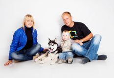 Family with puppy husky Stock Photography