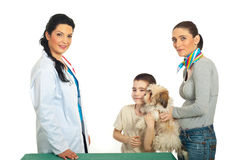 Family with puppy visit vet Royalty Free Stock Images