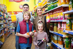 Family purchasing carbonated beverages. Family of customers with children purchasing carbonated beverages Stock Images
