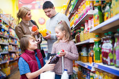Family purchasing carbonated beverages Stock Photos