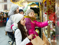 Family purchasing Christmas decoration and souvenirs Stock Images