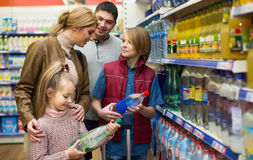 Family purchasing sparkling water in store Stock Photos