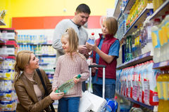 Family purchasing sparkling water in store Stock Photography