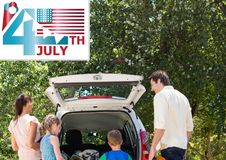 Family putting stuffs in boot for independence day. Digital composite of Family putting stuffs in boot for independence day Stock Photos