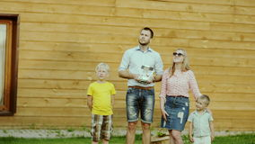 Family with Quadcopter Drone stock video footage