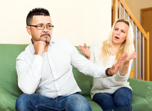 Family quarell in living room. Wife and husband are having a quarell over adultery in living room Stock Photography
