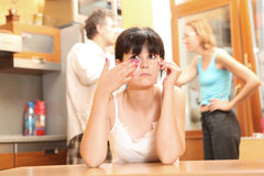 Family quarrel. The teenager suffers because of the conflict in family Royalty Free Stock Photo