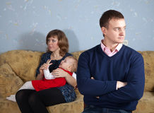 Family quarrel. Family of three having quarrel at home stock photos