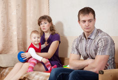 Family quarrel. Young family after quarrel in home Royalty Free Stock Photo
