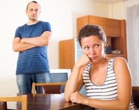 Family quarrel. Depressed family sorting out their relationship. Focus on the woman Royalty Free Stock Photography